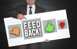 Feedback poster is held by businessman.  stock image
