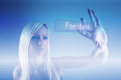 Feedback process. Girl touching feedback button Royalty Free Stock Photography