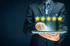 Feedback, review and rating concepts. Feedback, review and increase rating concepts. Digital tablet user give five stars in his review and feedback royalty free stock images