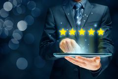 Feedback, review and rating concepts. Feedback, review and increase rating concepts. Digital tablet user give five stars in his review and feedback stock photography