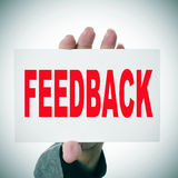 Feedback. Woman hand holding a signboard with the word feedback written in it stock photos