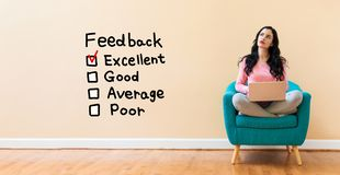 Feedback with woman using a laptop stock image