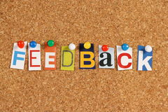 Feedback. The word Feedback in cutout magazine letters pinned to a cork notice board Royalty Free Stock Image
