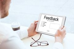 Feedback concept, writing review online. Feedback, writing review online, screen of device closeup stock photos