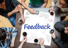 Feedback written on a poster with drawings of charts Royalty Free Stock Photo
