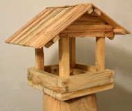 Feeder for birds. Wooden house with a roof. Manual work of a carpenter royalty free stock photography