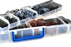 Feeder troughs of different colors and sizes in a plastic box for accessory. Close-up stock photos