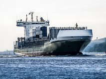 Ship arriving in the Port of Hamburg. Feeder vessel Heinrich Ehler on the Elbe heading for the Port of Hamburg royalty free stock images