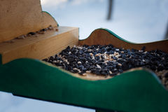 Feeders for birds in the winter snow garden with sunflower seeds Royalty Free Stock Image