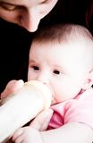 Feeding. Mother feeding her baby Stock Photography