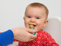 Feeding baby royalty free stock photography