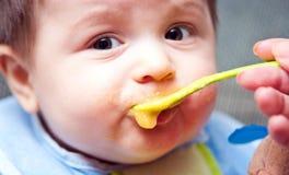 Feeding a baby Royalty Free Stock Photography
