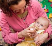 Feeding of a baby Royalty Free Stock Photo