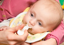 Feeding of a  baby Stock Photos