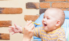 Feeding a baby Stock Photos