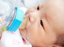 Feeding baby. Newborn baby feeding with a bottle Royalty Free Stock Photo