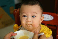 Feeding a baby Stock Image