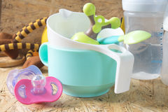 Feeding baby accessories. Bottles, teats on wood table Royalty Free Stock Photography