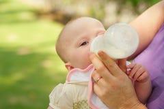 Feeding a baby Royalty Free Stock Photos