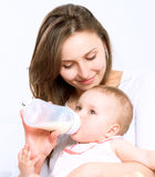Feeding Baby. Baby eating milk from the bottle Royalty Free Stock Photography
