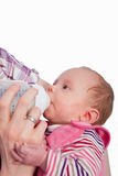 Feeding Baby eating milk from the bottle Stock Photography