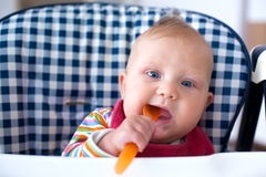 Feeding baby food to baby Royalty Free Stock Photography