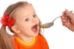 Feeding of baby girl pear. Stock Photography