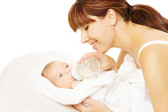 Feeding Baby. Newborn eating milk from bottle. Feeding baby. Newborn eating milk from bottle in Mother hand, white backgtound royalty free stock photos
