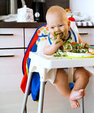 Feeding. Baby's first solid food Royalty Free Stock Images