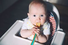Feeding. Baby& x27;s first solid food Stock Photo