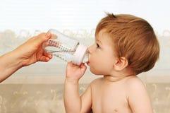 Feeding a baby. Royalty Free Stock Image