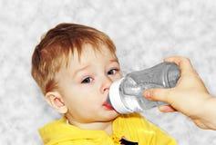 Feeding a baby. Royalty Free Stock Photography