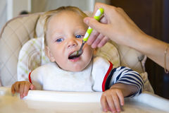 Feeding baby with a spoon Stock Photo