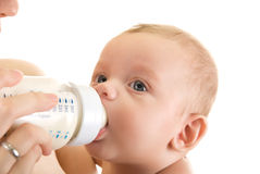 Feeding bottle. Mother give drink her baby boy by feeding bottle Stock Images