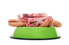 Feeding bowl full of meat and sausage Royalty Free Stock Image