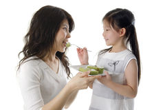 Feeding cake for mama Stock Photography