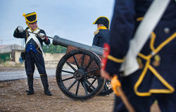 Feeding the cannon Stock Images