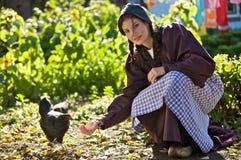 Feeding the chickens Royalty Free Stock Photo