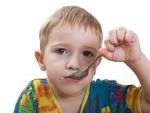 Feeding child Stock Image