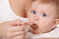 Feeding of the child Royalty Free Stock Photo