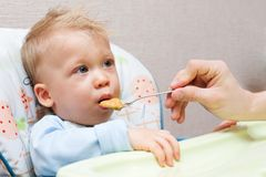 Feeding a child Royalty Free Stock Image