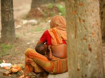Feeding child. Mother feeds her baby on the street,Life in Dhaka city,Bangladesh stock photography