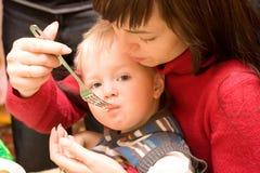 Feeding a child stock photo