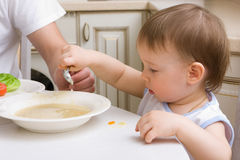 Feeding child stock images