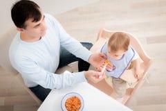 Feeding child Stock Photos