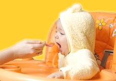 Feeding cute baby boy 4 Royalty Free Stock Image
