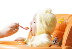 Feeding cute baby boy 8 Stock Photo