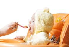 Feeding cute baby boy 8 Stock Photo