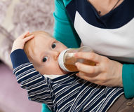 Feeding cute little son Royalty Free Stock Images