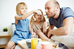 Feeding dad Stock Images